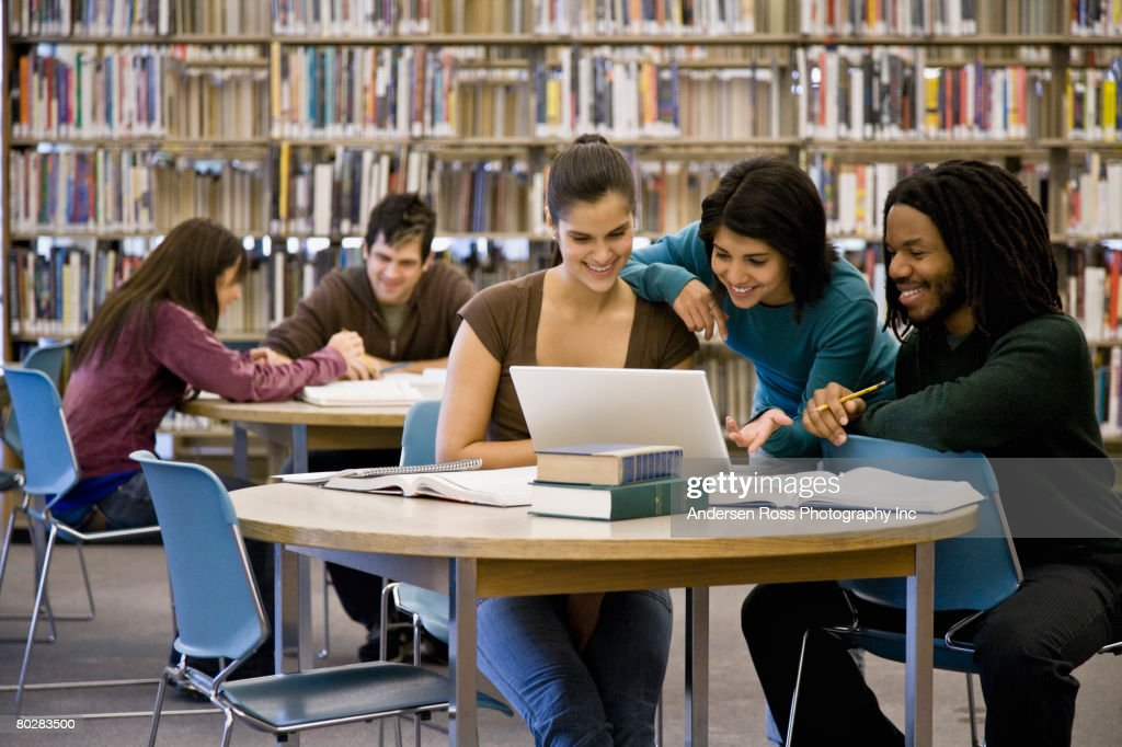 Multi-ethnic college students studying at library