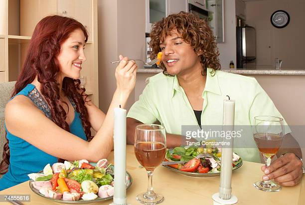 Multi-ethnic couple at restaurant
