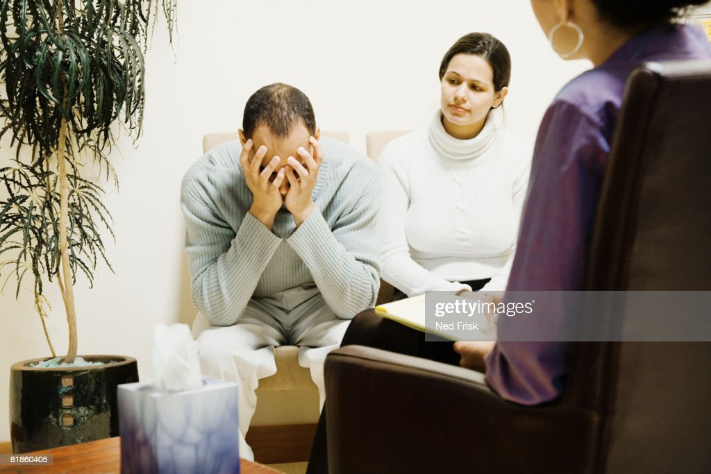 Multi-ethnic couple at therapy session : Stock Photo