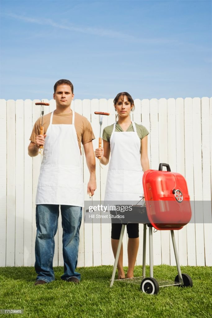 Multi-ethnic couple barbequing