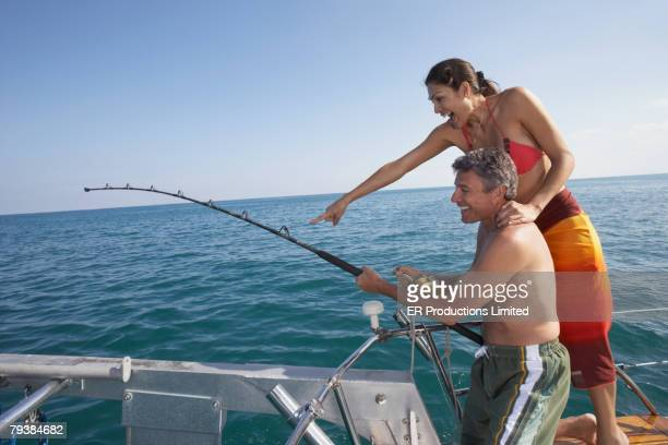 Royalty Free Topless Fishing Pictures, Images and Stock