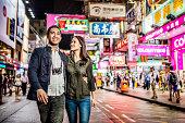 Multi-ethnic couple in Hong Kong walking street
