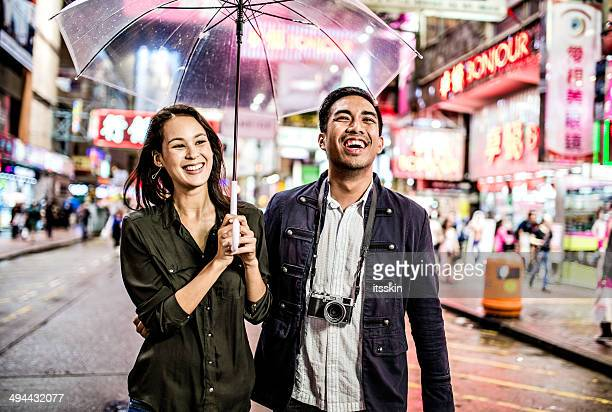 Multi-ethnic couple in Hong Kong walking street