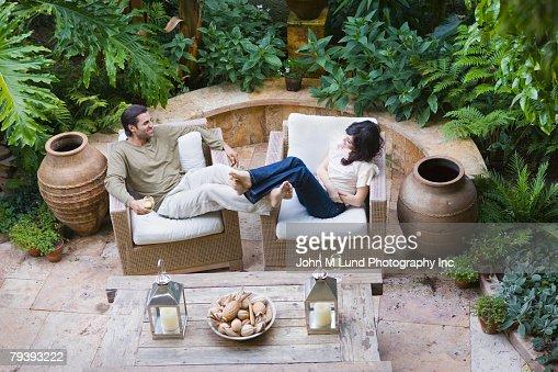 Multi-ethnic couple relaxing outdoors : Stock Photo
