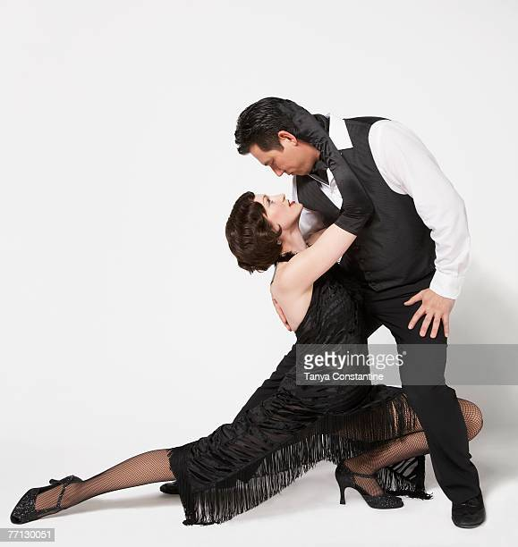 Multi-ethnic couple tango dancing