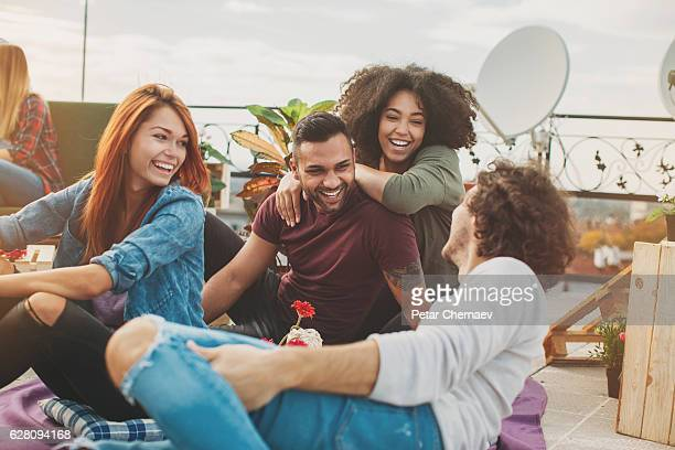 Multi-ethnic couples chatting on the rooftop