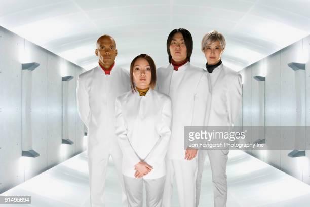 Multi-ethnic co-workers in futuristic setting