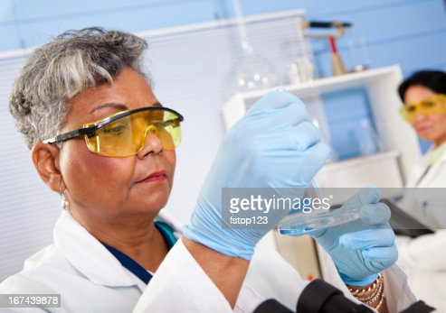 Multi-ethnic doctors or scientists running tests and observing results