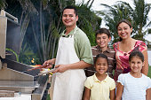 Multi-ethnic family barbequing