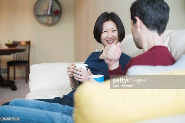 Multi-ethnic family, caucaian man and korean woman, at home