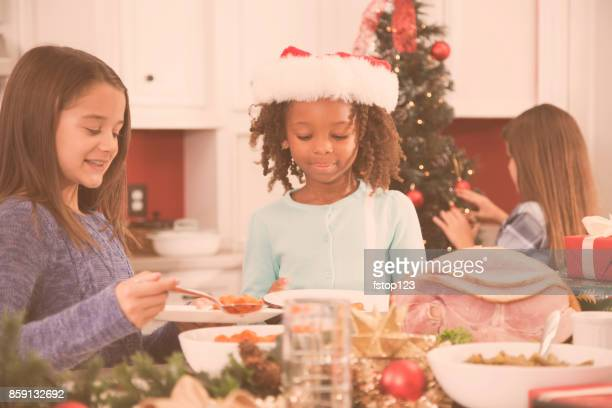 Multi-ethnic family in home kitchen at Christmas.