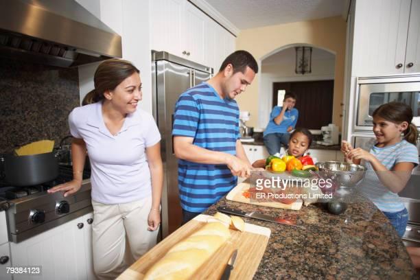 Multi-ethnic family preparing food