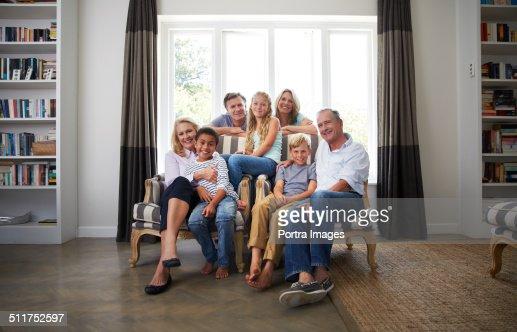 Multi-ethnic family smiling in house