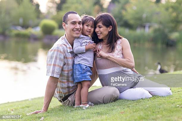 Multi-Ethnic family snuggling together in the park