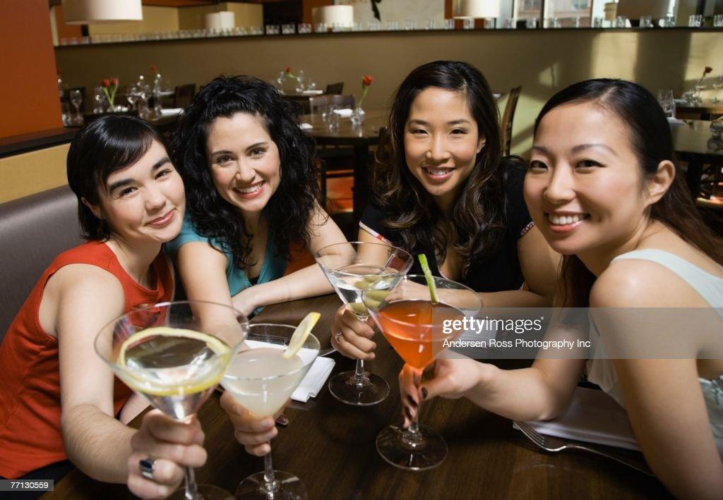 Multi-ethnic female friends at bar : Stock Photo