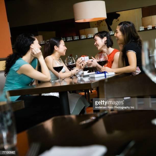 Multi-ethnic female friends at bar