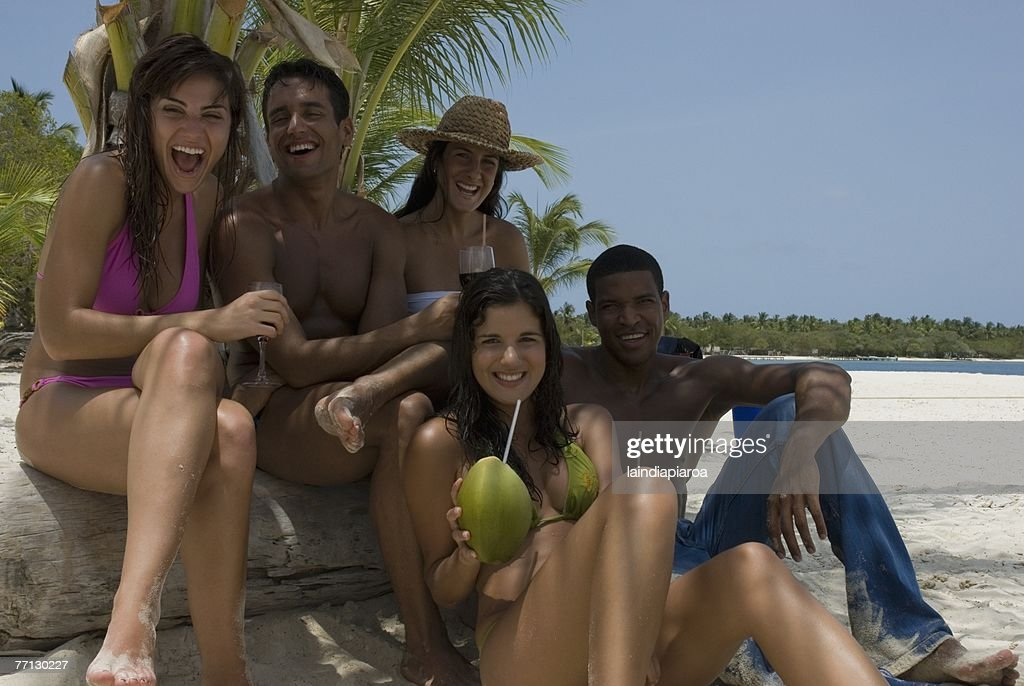 Multi-ethnic friends at beach : Stock Photo