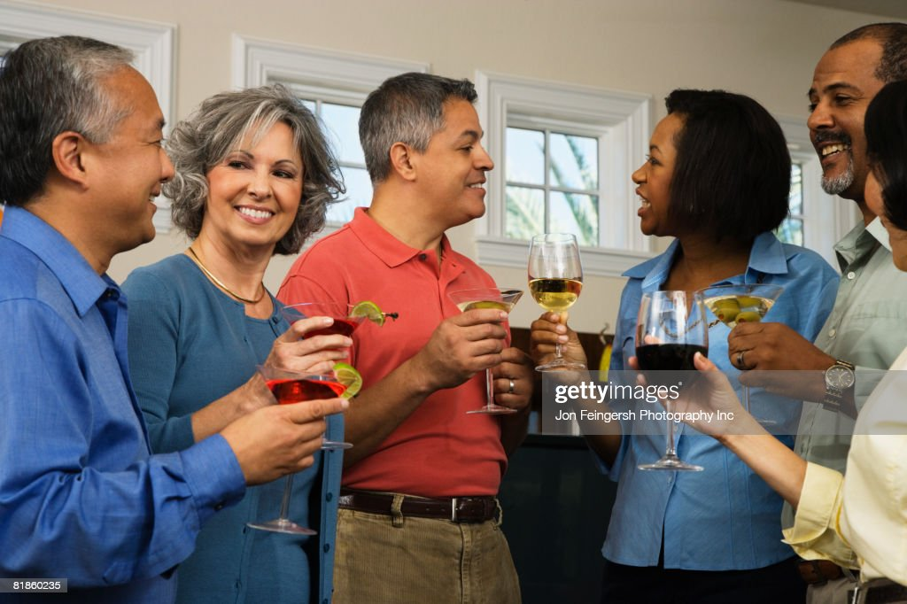 Multi-ethnic friends at party : Stock Photo