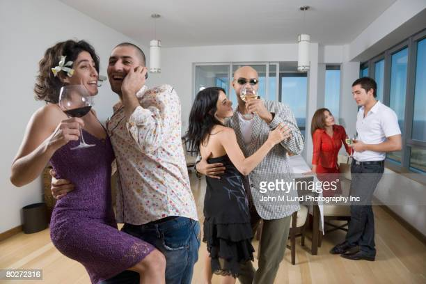 Multi-ethnic friends dancing at party