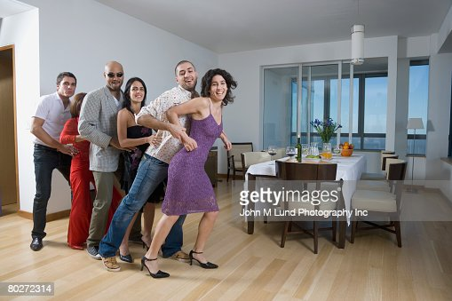 Multi-ethnic friends dancing conga line