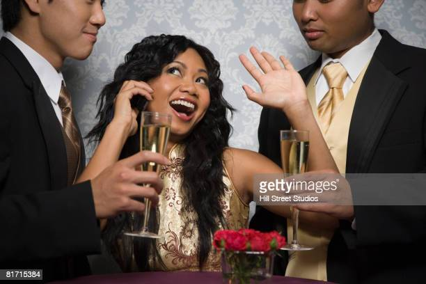 Multi-ethnic friends drinking champagne