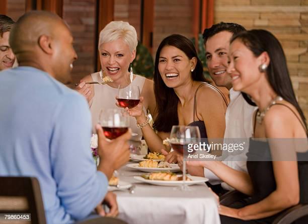 Multi-ethnic friends eating at restaurant