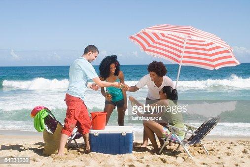 Multi-ethnic friends enjoying the beach : Stock Photo