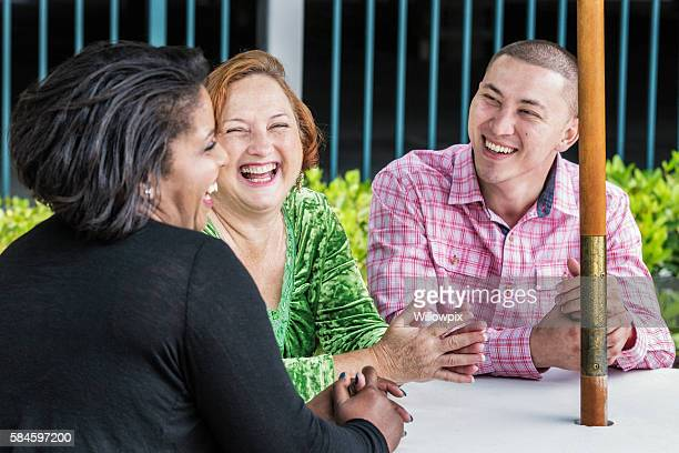 Multi-Ethnic Friends Laughing Sharing Outdoors Team Meeting Joke