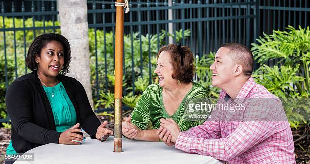 Multi-Ethnic Friends Laughing Together At Outdoors Team Meeting