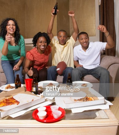 Multi-ethnic friends watching sports on television : Stock Photo