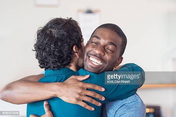 Multi-ethnic gay couple embracing
