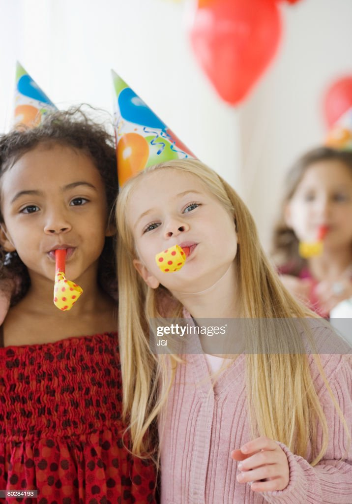 Multi-ethnic girls at birthday party : Stock Photo