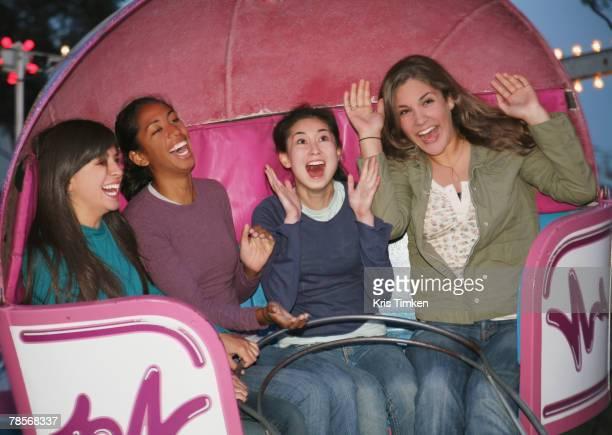 Multi-ethnic girls on amusement park ride