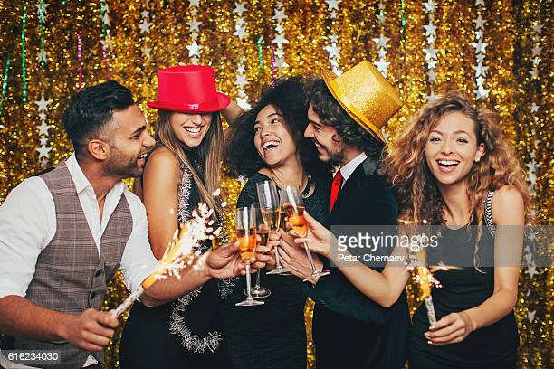 Multi-Ethnic group celebrating with champagne