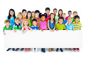 Multiethnic Group of Children Holding Empty Billboard