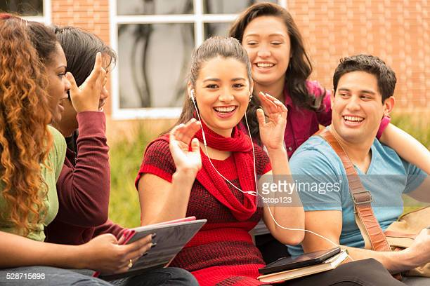 Multi-ethnic group of college student friends. Digital tablets.