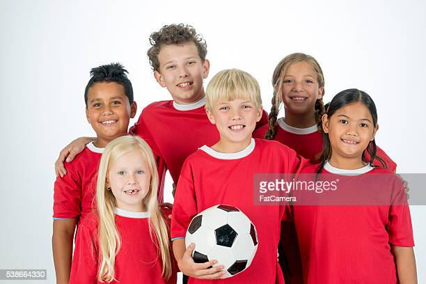 A multi-ethnic group of elementary age children are