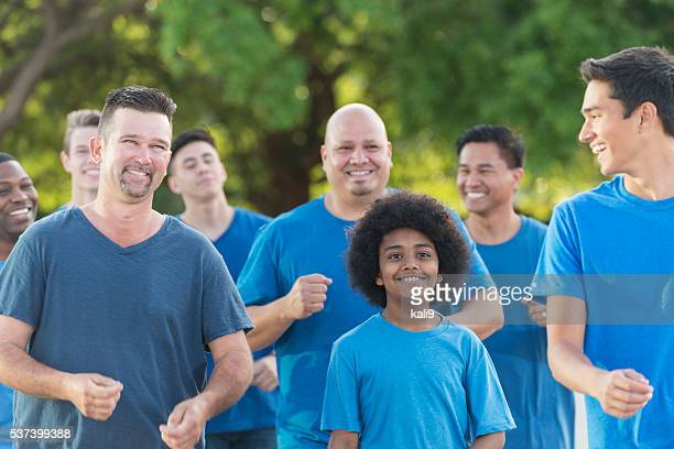 Multi-ethnic group of fathers and sons walking together