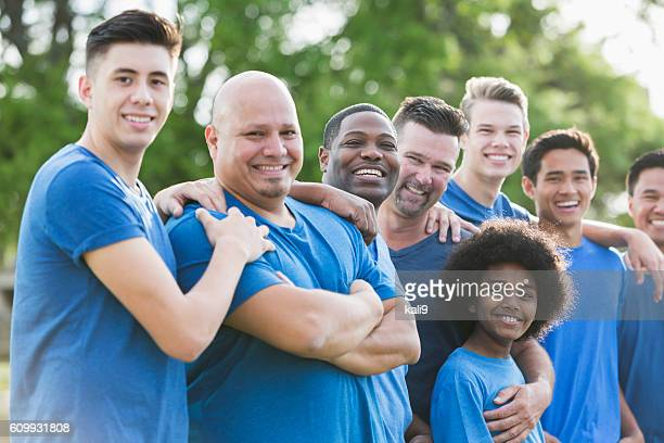 Multi-ethnic group of men and sons standing outdoors