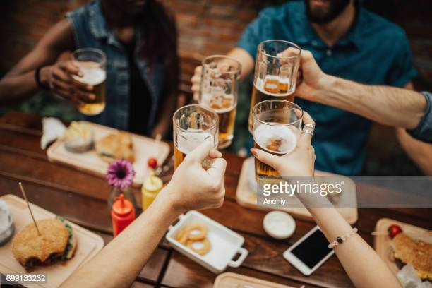 Multi-ethnic group of people celebrating social gathering at the pub
