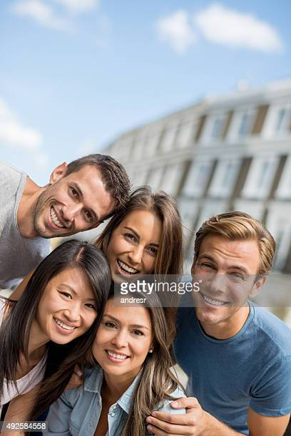Multi-ethnic group of people looking at camera smiling