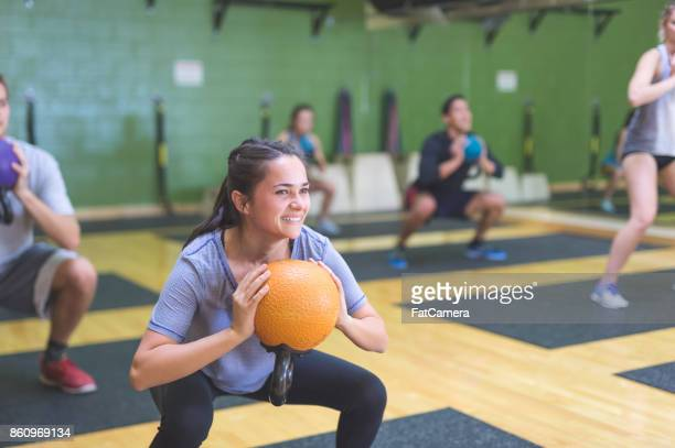 Multi-ethnic group of people working out  at fitness facility