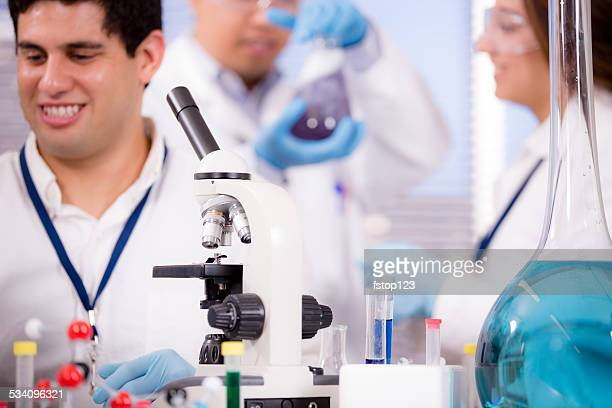 Multi-ethnic group of scientists in research laboratory. Science experiments.