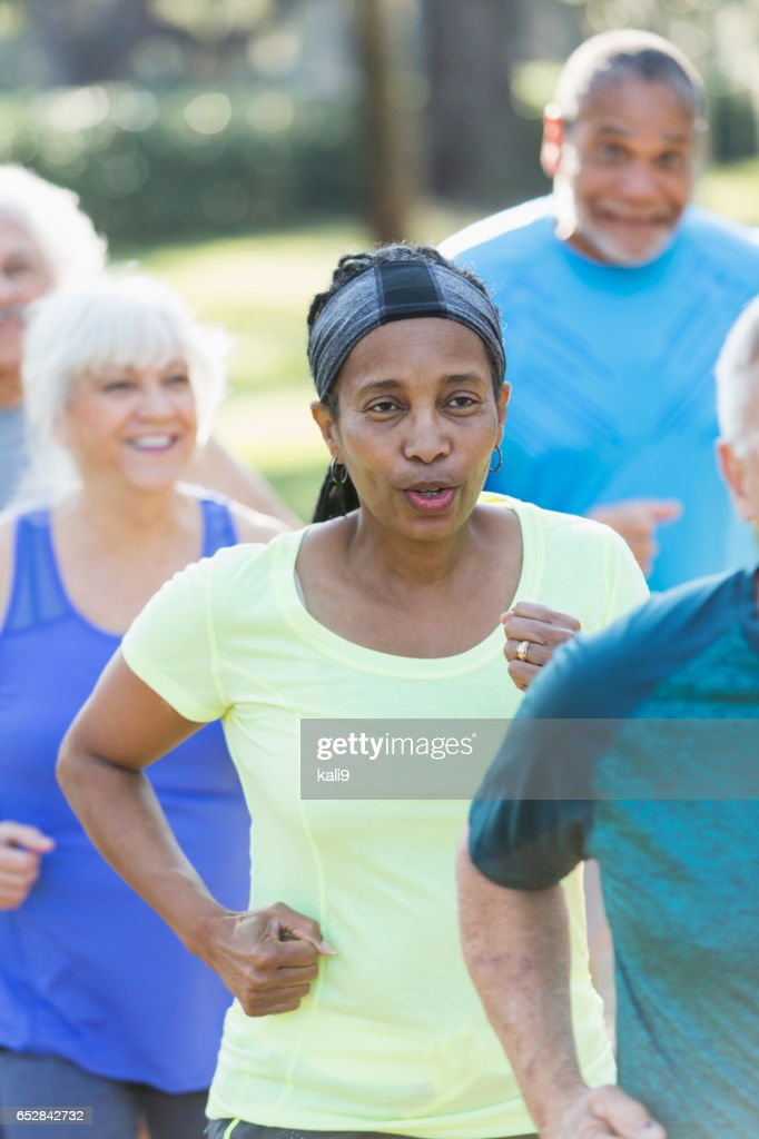 Multi-ethnic group of seniors running in park : Stock Photo