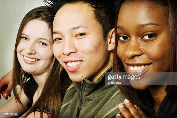 Multi-ethnic group of smiling young adults