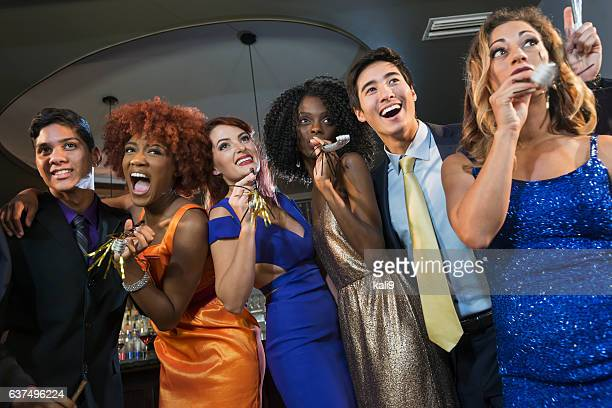 Multi-ethnic group of young adults at a party