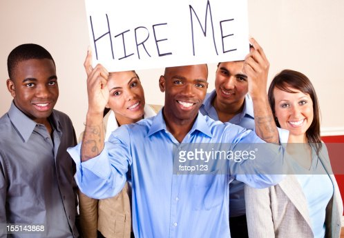 Mixed Ethnic Group of Young Adults with Hire Me Sign