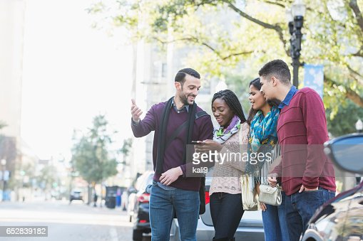 Multi-ethnic group of young adults waiting for ride : Stockfoto