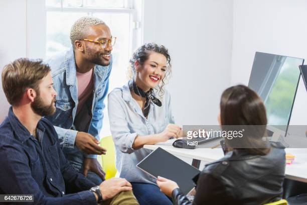 Multi-ethnic group of young creatives brainstorming
