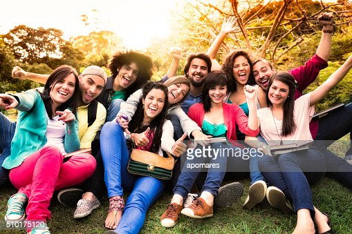 Multi-ethnic group of young students having fun at university campus
